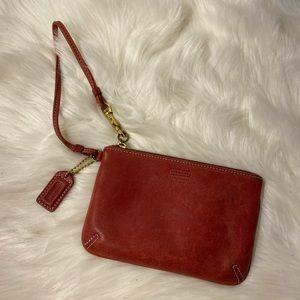 Coach leather wristlet, mauve color hue pre loved